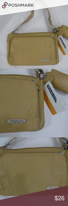 Travelon Butterscotch Leather shoulder bag New 173 New leather bag is butterscotch color and the one strap is a shoulder style. This also has a matching phone case BUT is for older flip phones ... most phones today are too large for it.   This comes with a black belt that i think is for using this bag as a fanny pack .  This was a 2010 style and was from an estate collection. Travelon Bags Shoulder Bags