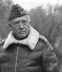 Gen. George C. Patton in one of his favorite shearling bomber jackets, c. 1944.