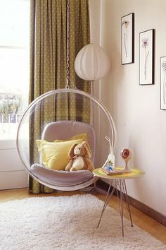 Hanging Chair.  I saw one of these in a Spice Girls poster when I was a kid and spent my whole childhood/teenage years trying to explain to my parents what it was because I wanted one.  This is what I was talking about, mom!