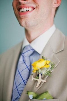 Adorable yellow bout with an airplane. Bout by Bows + Arrows. Photo by Apryl Ann Photography. #wedding #boutonniere #yellow #rose #airplane #travel #navy