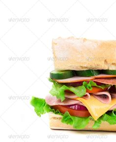 Close up of french sandwich. ...  background, baguette, beef, bread, breast, cheese, closeup, fast, food, green, ham, hand, healthy, isolated, lettuce, long, lunch, meal, meat, onion, pork, poultry, rolled, salami, sandwich, slice, snack, sub, subway, takeout, tasty, tomato, turkey, vegetable, white