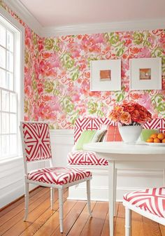 floral wallpaper, geometric fabric on chairs