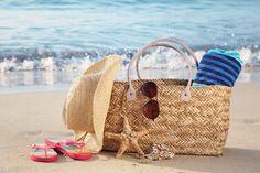 Summer beach bag on a sandy beach