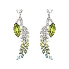 BO BRINS DE PRINTEMPS « Brins de Printemps » earrings in 750 white gold set with 2 marquise-cut peridots for a total weight of 10.4 cts, 4 marquise-cut peridots for a total weight of 1 ct, 20 brilliant-cut peridots, 6 marquise-cut green tourmalines for a total weight of 1.4 ct, 4 pear-cut aquamarines and 146 brilliant-cut diamonds. Photo : Chanel Fine Jewelry