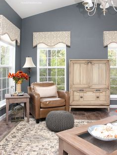 Armoire turned tv cabinet. Perfect way to keep your television from being the center of attention.