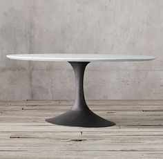 RH s Aero Marble Oval Dining Table Paying homage to the sweeping