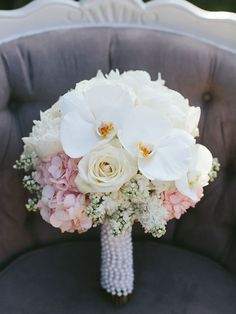 This bouquet by The Flower Shop at Thiessen's is perfect for the classic, vintage bride! As seen in Canada's Most Beautiful Bouquets For 2015.