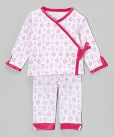 Wrap a bundle of joy in soft, cuddly cotton with this sweetly styled set. The satin trim is extra pretty alongside the outfit's delicate print.