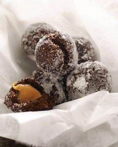 These quickly fried, chocolate-cakey doughnut holes boast a molten center of liquid caramel.