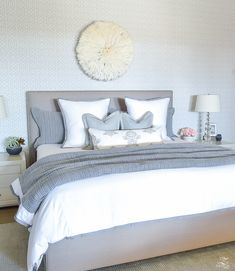 white and gray transitional bedroom spring decor in the bedroom pottery barn honeycomb bedding juju hat gray uholstered heaedboard-1