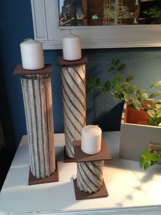 Barrotes de madera reciclados en candelabros. Restaurados en Barcelona por Malana's workshop