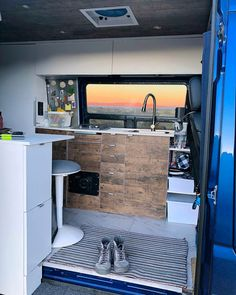 Nice modern and clean van life layout. Lots of desk space and it looks so cozy. I am definitely going to save this for my next campervan build!