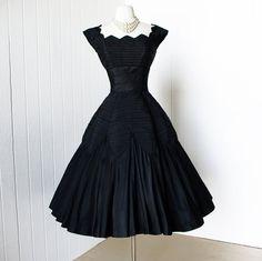 ~ The crème de la crème!  1950s ceil chapman black (feels like) silk cocktail party dress...gorgeous.