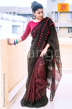 Lovely black saree with pink tassels Best Indian Sarees Click VISIT link for more details Saree Blouse Patterns, Saree Blouse Designs, Indian Attire, Indian Wear, Indian Dresses, Indian Outfits, Beautiful Saree, Beautiful Dresses, Beautiful Ladies