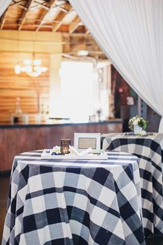 loving on these buffalo plaid black and white tablecloths // barnyard wedding + fall vibes Fall Table, Thanksgiving Table, Christmas Tables, Holiday Tables, Winter Table Centerpieces, Flowerless Centerpieces, Table Decorations, Black And White Tablecloth, Plaid Wedding