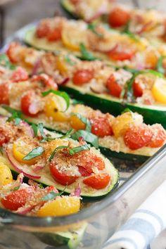 Bruschetta Hummus Stuffed Zucchini is the perfect summer side dish you'll want to eat all season long.