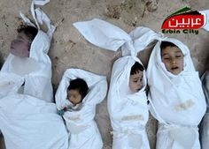 This citizen journalism image provided by the Local Committee of Arbeen which has been authenticated based on its contents and other AP reporting, shows dead bodies of Syrian children after an alleged poisonous gas attack fired by regime forces, according to activists in Arbeen town, Damascus, Syria, Wednesday, Aug. 21, 2013.