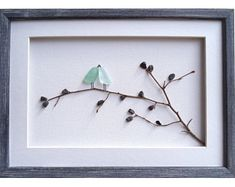This sea glass art will be a great wedding gift for the new family. Pebbles and shells are used on a canvas to create the images of a groom and bride. A twig and genuine sea glass in various shades of green are used for image of a tree. All materials are hand-collected by me from the beautiful beaches around my hometown Varna, Black Sea coast. Framed with a white matting and custom made wooden frame in vintage style. The frame is handmade, hand painted and distressed. The picture is ready to…