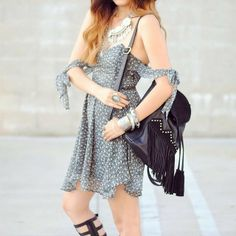 Rubi in our Floral Kiss Me Dress and Studded Suede Tassel Backpack.