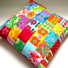 A fab retro fabric cushion / pillow cover made from bright vintage 1960s fabrics and contemporary pieces,very bright tones or tangerine,