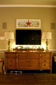 Want the mirror above the TV and a trough made below, with hole drilled for lights.