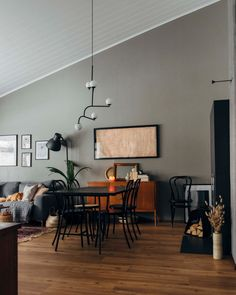 High ceiling living room with grey wall.  Pinossa | Pinossa-blogissa sisustetaan pienen perheen kotia rennolla otteella Marimekko, Lifestyle Blog, Interiors, Vintage, Home, House, Ad Home, Decoration Home, Interior