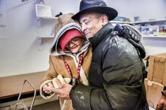 """Margie Peal embraces the Rev. Willie Johnson after he brought her a hot dog at the Manna From Heaven food pantry. Peal said, """"I come off and on because I know others need the help more. But, sometimes, it gets rough."""" For 10 years, Manna From Heaven has managed to survive, feeding all who are hungry with no questions asked. The small operation that runs out of a storefront at 607 S. Western Ave. is run completely by volunteers and donations. Each Tuesday session opens with songs of praise ..."""