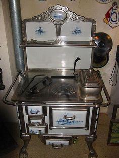 Beautiful Antique Art Nouveau kitchen stove enamelled Delft Painting around 1920.  Heike