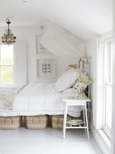 Bright, cozy bedroom under the rafters.