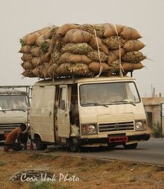 Overloaded #Vans and #Trucks you can see in #Benin