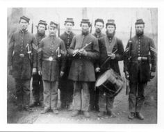 Early war image of the 12th Indiana Infantry. Charles F. Nelson stands in the center.