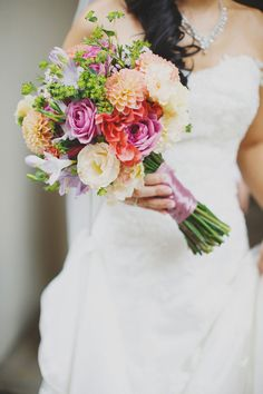 Colorful wedding bouquet with lavender, lilac and orange blooms | A Vintage Garden Wedding at The White Rabbit: Julien + Theora