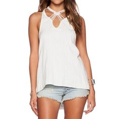 Free People - One and Only Tank BNWT Sleeveless and slouchy pull on design with pretty knotted rope detail on the front! Dropped armholes, racer back, hi-lo hem, 100% cotton with two hidden side pockets. Free People Tops