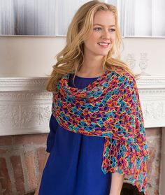 Happy-Go-Lacy Shawl Free Crochet Pattern in Red Heart Yarns - It folds up compactly so it's perfect to take along and use as a scarf or shawl whenever you need a light layer of warmth.
