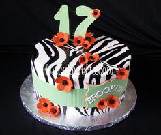 Hand painted zebra stripe fondant cake with sugar flowers. By thecakeattic.com in Salisbury, NC www.facebook.com/thecakeattic