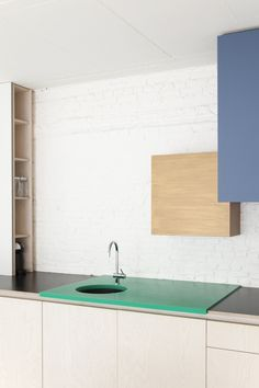 I will have french black with a red or grey section 'under counter' below the bench with an under counter sink @Dries Otten Color Block Kitchen | Remodelista