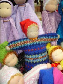Puppenstube.  I love the colorwork sweater doll.