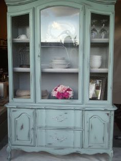 I want this Shabby Chic hutch so bad that it hurts! Painted with Annie Sloan's Duck Egg Blue and Chicken Wire. I am so in love!