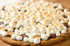 Outrageous Grilled Chocolate Chip Cookie S'more Dessert Pizza |  Instead of your typical plain pizza crust,a large chocolate chip cookie is used in its place.  For this recipe you can use either store bought or homemade cookie dough. #pizza