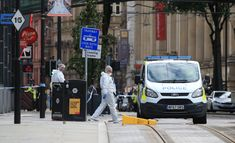 Police forensics officers work outside Arndale Centre shopping complex in Manchester, northwest England on October 11, 2019, following a series of stabbings. -(Photo by Lindsey Parnaby / AFP) (Photo by LINDSEY PARNABY/AFP via Getty Images)