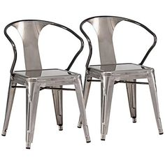 A set of two industrial-inspired steel dining chairs with tapered legs and a slim backrest design.