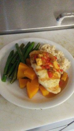 Carribean style grilled Chicken w/ Asparagus Sweet potatoes and Rice