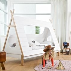 This amazing, luxury Kids Teepee Tent Bed is the ultimate design feature for any kids room. Constructed from solid pine in white veneer, your little adventurers will love this bed, with its lookout holes at either end and hideaway teepee features. The exposed pine frame gives an authentic look, perfect for cowboys and cowgirls to hang up their hat after a hard days play!  Slats are included. Height 159 cm Width 215 cm Depth 106 cm. Please Note: Mattress not Included. A continental size…
