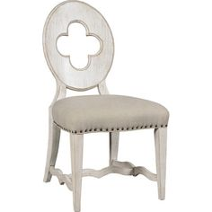Featuring an open quatrefoil back and upholstered seat, this lovely side chair lends an understated touch of style to your dining table or breakfast nook.