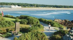 One of the prettiest strolls you'll take in southern Maine is the mile-long Marginal Way, which stretches from downtown Ogunquit's Shore Road to the docks at Perkins Cove. The paved pathway winds alongside coastal Maine's spectacular shoreline, with views of the sprawling beach and sea in one direction, and Ogunquit's scenic cottages and shops in the other. Breathe in the salty air and note the distant lighthouse which serves as the scene's perfect exclamation point.