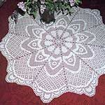 """Parasol Table Topper Pattern in Filet Crochet (FT404) This Table Topper is Crocheted in Rounds, starting in the center. The fan-like design adds a new look to traditional Filet techniques. When made out of thread #20, the finished size is about 34"""" (98 cm) in diameter. If you use Thread #10, it is about 50"""" (127 cm) in diameter, the perfect size for a small round table. Pattern $3.25"""