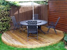 round deck like what he wants. sweet simple and to the point, just in front of the door and higher.