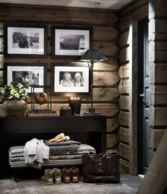 Cozy cabin entryway. The fabric-covered bench is the perfect complement to the wood walls.