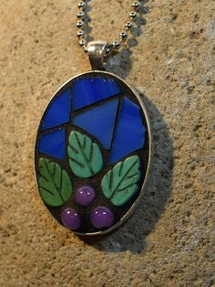 I assembled this mosaic on an antiqued silver pendant tray, using rich deep blue stained glass, lucite leaf shapes and purple Mosaic Diy, Mosaic Crafts, Mosaic Glass, Stained Glass, Mosaic Ideas, Resin Crafts, Jewelry Tools, Glass Jewelry, Jewelry Design
