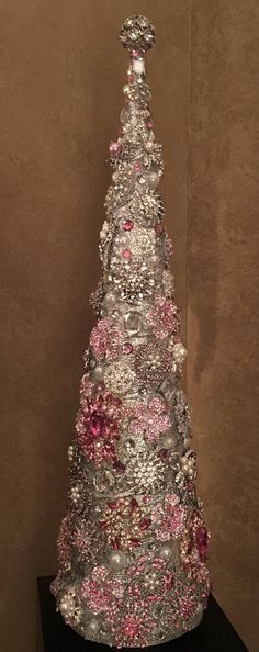 Stunning 26 Pink and Silver Rhinestone Tree. The elegant tree is handmade with care. This piece is encrusted with pink and silver jewels all over a silver base. I strive to create the most unique and beautiful pieces possible. This is a show stopper and will add elegance and beauty